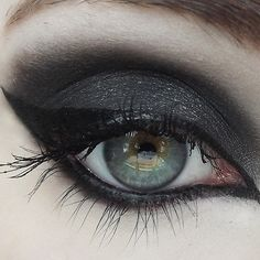 (Black w/ silver sparkle) Whether you're from the grim and frostbitten forests of Norway, or you just really dig a good, sultry black, this color will not disappoint! Best used as a contour. Try addin