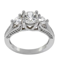 Amelia - Celebrate your engagement or anniversary with this dynamic three-stone ring!  Its shimmering band features ribbon-like rows of accents, sweeping up into romantic trellis settings for the three focal stones.    1.03 carat Round Brilliant cut center stone  Amelia: Two 0.25 carat side stones  1.72 total carats