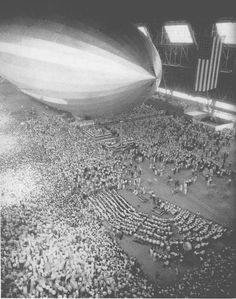 Commissioning ceremony for either the USS Akron or the USS Macon. These ridged airships, were flying aircraft carriers, that's the difference between them and blimps. Blimps were the K-Ships, the ZP Squadron. A big thank you to James Yarger, for the info.