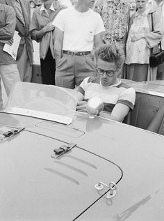 Jimmy sit-tests a red Ferrari 375 Mondial at Santa Barbara Memorial Day race, , where he's racing his Porsche 356, May 29, 1955.