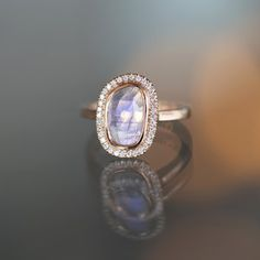 Moonstone and diamond halo ring in rose gold at Sarah O. Jewelry in Denver, CO
