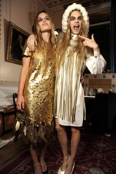 Georgia May Jagger and Cara Delevigne messing around backstage at Giles Deacon