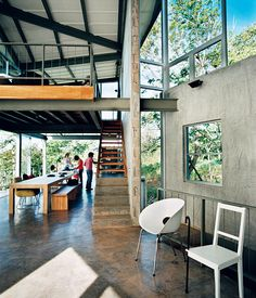 Exposed beams and a cantilevered loft soar over the high-traffic eating area, giving the family a sense of spaciousness.  Photo by Paco Perez.