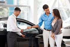 Photo about Car Showroom. Young Couple Buying a New Car at Dealership. Image of customer, dealer, sales - 61018462 Buying New Car, Lexus Gx, Car Cost, Vintage Graphic Design, Young Couples, Car Manufacturers, Car Photos, Driving Test, Used Cars