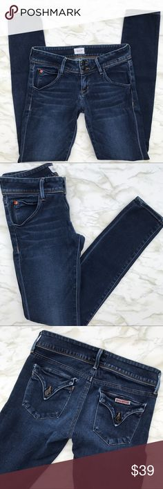 Hudson Collin Skinny Jean in Size 26 Get these premium denim jeans for a fraction of the retail price.  In great condition, these dark blue jeans have whiskering on the front to add a little dimension.  With the classic Hudson pockets, you'll look just as great from the back as you do from the front.  The skinny leg on these are perfect for wearing with heels, tucking into boots, or pairing with your favorite sneakers.  These jeans feature a zip fly & double button closure, 5 pockets…