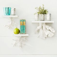 Floating wall shelves made with coral then spray painted white