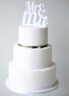 Very simple wedding cake, but beautiful. Add some baby's breath and a navy ribbon and it's perfect