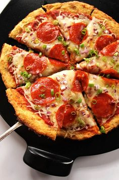 Easy Cauliflower Pizza Crust - A HEALTHY, delicious, pizza crust that won't fall apart. You can top the pizza with anything you prefer. Gluten Free.  robustrecipes.com