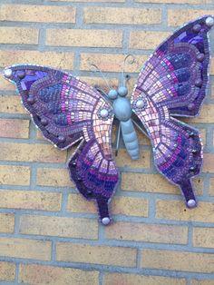 Paars/lila vlinder. 54 cm, 65 euro.