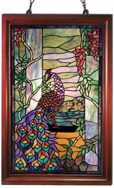 This Peacock wooden window panel has been handcrafted using methods first developed by Louis Comfort Tiffany.