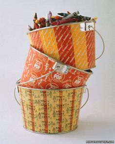 Tin paint buckets become something else entirely when they're decoupaged with Halloween-candy wrappers, especially some of the older, prettier ones -- like Mary Janes, which have a vintage charm. Colorfully patterned, these buckets can be used to hold anything from crayons to loose change, or use them on Halloween night to pass out treats. Simply apply Martha Stewart Crafts decoupage glue to the bucket with an inexpensive paintbrush, smooth out wrappers, and then coat the outside with mo...
