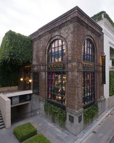 The new RRL facade in Tokyo, Japan presents a bold contrast to the existing Ralph Lauren flagship store – the stable from which it springs. Warehouse Living, Warehouse Home, Brick Building, Building Exterior, Amazing Architecture, Interior Architecture, Industrial Architecture, Loft Design, House Design