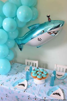 Are you planning a shark themed party soon? Get inspired with a fin-tastic shark birthday party! Discover simple shark party decorations, shark fin cupcakes and a unique shark inspired backdrop!