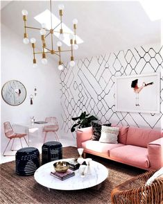 Just look at that pink sofa and mid-century light