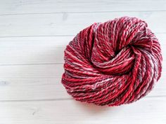 Cherry & Grape is a delicious worsted-to-bulky weight yarn - the roving was lovingly hand-dyed and then spun in 2-ply, leading to lovely lengths of semisolid/tonals and barber-pole pinks, reds, and purples. Because of the handspun nature of this yarn, there will be some inconsistencies in the weight - some sections may be slightly thinner than other sections. This yarn is kettle dyed using hand-placed professional acid dyes, then spun and plied. I wash all yarns after dyeing, but it may…