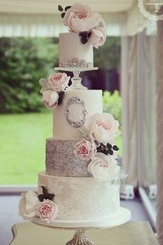 gorgeous sugar flowers, lace and sequin wedding cake with pedestal separator topper //  cotton and crumbs