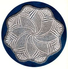 Knitted Doily pattern from Doilies, originally published by American Thread Co, Star Book No. 124, in 1955.