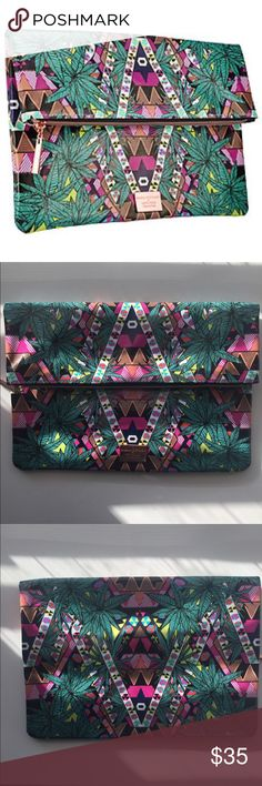 mara hoffman for sephora clutch mara hoffman for sephora 'kaleidoscope' fold over clutch. NWOT. limited edition piece.   I ♥️ reasonable offers 🛍 bundle discount- 2 items @ 20% off! ❌ no trades/🅿️🅿️ 🚭 smoke free home Bags Cosmetic Bags & Cases