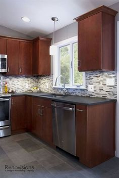Contemporary Kitchen Remodel By Renovisions. Stainless Steel Appliances,  Glass Mosaic Backsplash Tiles, Stainless