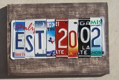 My neighbors have their house number with license plates numbers. Cool idea.    Etsy.com- shop: plateworks