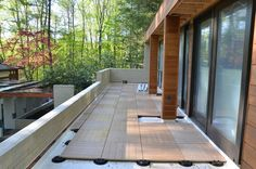 Kronos 'Ebano' wood look pavers  installed with fixed height support pads