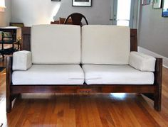 DIY sofa made form old doors... it's relatively cheap option, but extremely labor intensive (stripping, etc). I would probably just paint over the doors, rather than strip them. Also, I don't have sofa cushions which I especially like...