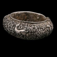 Spectacular bracelet, covered inside and out with repousse. Created in Nepal where a talented artisan certainly spent weeks honing its perfection. The breathtaking scroll work on this bracelet makes it a past and future heirloom. Buddha Jewelry, Tribal Jewelry, Indian Jewelry, Silver Bangles, Silver Jewelry, Silver Ring, Silver Earrings, Jewelery, Jewelry Bracelets