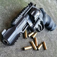 Railed Revolver. Cool as f*ck revolver that can mount optics and lights.