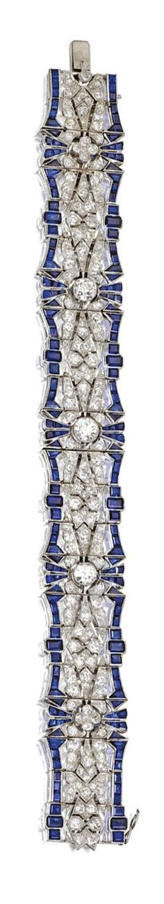 SAPPHIRE AND DIAMOND BRACELET, CIRCA 1925/ The flexible openwork strap set with 3 old European-cut diamonds weighing approximately 1.95 carats, further set with numerous old European-cut and single-cut diamonds weighing approximately 7.95 carats, bordered by numerous calibré-cut sapphires, mounted in platinum. ★ re-pinned by http://www.wfpcc.com/jupiterisland.php