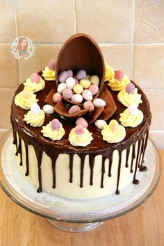 Vanilla Cakes layered with Vanilla Frosting, a Dark Chocolate Ganache Drip, & packed full of Mini Eggs – The perfect Easter Showstopper! I posted a photo of a 'drip cake' a f… Easter Recipes, Dessert Recipes, Easter Desserts, Cake Recipes, Vanilla Cake, Vanilla Frosting, Ganache Icing, Mini Eggs Cake, Easter Cake With Mini Eggs