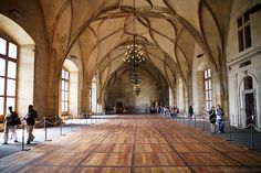 In this picture shows the Vladislav Hall's interior (looking east) in Prague Castle located in Czech Republic. It was the largest hall in medieval Prague and a largest secural hall in the whole Central Europe. The Vladislav Hall is 60 meters long and 16 meters wide and the arches of the room are 12 meters high. The nave is created with into decorative curving vault with a complex interlocking design and, cut-off ribs through the middle of the roof.