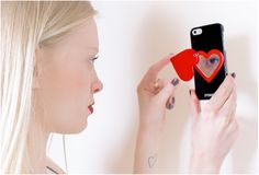 """Lovely Laura Sophie checking herself out in our Miroir Au Portable """"Love Is In The Air"""", available for iPhone 4/4S and iPhone 5/5S"""