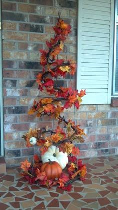 This has lots of potential!  Fall tree made with a tomato cage. IDEA: make one for Halloween with spider webs and spiders and other things that are pretty creepy looking! by Vicki Moody