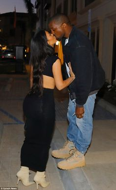 It's love all right: Kim Kardashian planted a kiss on Kanye West when they went out on a date in Los Angeles on Saturday night