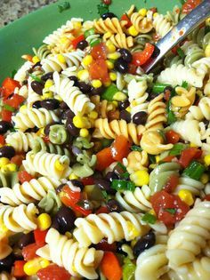 Black Bean & Corn Pasta Salad. We added in grilled chicken. Makes tons and everyone wants the recipe!