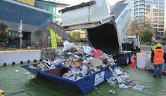 Recycling truck tips its load in Aotea Square. To demonstrate the amount of rubbish and types of wrong things people put into their recycling bins