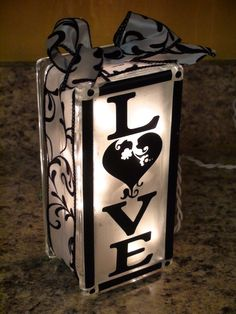 Made from a frosted glass block filled with lights (found at large craft stores like Hobby Lobby) and decorated with stickers or stencils and ribbon. Perfect for a gift or simple decoration. Cute Crafts, Crafts To Make, Arts And Crafts, Diy Crafts, Vinyl Projects, Diy Projects To Try, Craft Projects, Halloween Projects, Craft Ideas