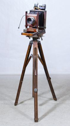 Having a Kodak Supermatic Graphic lens; together with a wood tripod, extra Kodak lens, two film loaders, four plastic film holders and four wood film holders Kodak Lens, Sticky Back Plastic, Old Cameras, Plastic Film, Plastic Design, Movie Camera, Camera Tripod, November 2015, Tripod Lamp