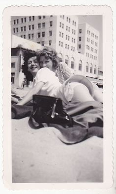 Affectionate beach friends, 1940s.