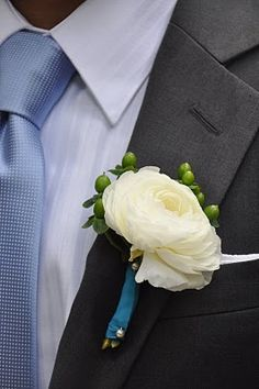 Ranunculus and hypericum berry boutonniere