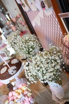 mason jars wrapped with doily with babys breath centerpiece