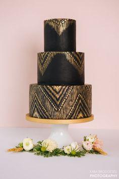This sleek black and gold cake.
