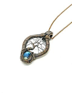 This is a one of a kind tree of life blue crystal pendant showcased in an oxidized copper wire cage. The unique labradorite crystal gives an incredible nurturing vibe echoed by blue hues reminiscent of great Mother Nature. Wire Necklace, Copper Necklace, Copper Jewelry, Copper Wire, Crystal Necklace, Necklace Lengths, Gemstone Jewelry, Necklaces, Moonstone Pendant