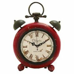 """With a distressed finish and retro-chic silhouette, this charming table clock brings a warmly weathered touch to your den or office.   Product: Table clockConstruction Material: Steel alloyColor: Aged redAccommodates: Batteries - not includedDimensions: 10"""" H x 7"""" W x 3"""" D"""