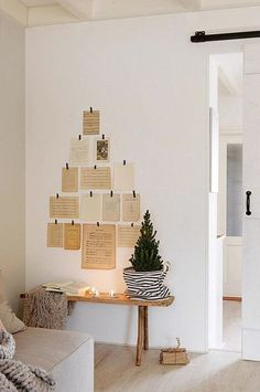 Christmas Decorations in a Bright Dutch Cottage –Subtle Christmas Decorations in a Bright Dutch Cottage – alternative Christmas tree ideas wall decoration green branches Taylor Extra Large Hurricane Candle Holder Advent Calendar swee. Hygge Christmas, Christmas Mood, Noel Christmas, Simple Christmas, Minimalist Christmas Tree, Christmas Tables, Nordic Christmas, White Christmas, Christmas Cookies