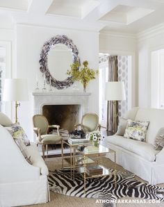 love the mirror and the zebra rug - also the wall treatment and drapes in the adjoining room