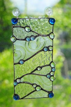 Stained Glass I Love! ❤ One-of-a-kind, original stained glass design. Made with reclaimed clear textured glasses and blue, green, and clear beads. www.peaceloveglass.com