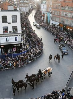 Procession: Crowds up to ten deep line the streets of Leicester yesterday to watch Richard's coffin borne on a horse-drawn gun carriage