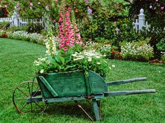 Love this Green Wheelbarrow and the Beautiful Garden