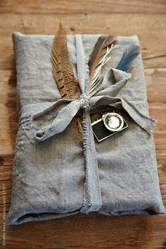 Hipster gift wrapped in linen with feathers and vintage camera by Trinette Reed - Stocksy United Creative Gift Wrapping, Creative Gifts, Wrapping Ideas, Hipster Gifts, Western Christmas, Gift Wraping, Wedding Gifts For Guests, Christmas Wonderland, Candy Gifts
